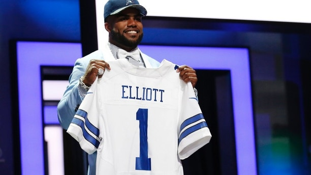 Apr 28, 2016; Chicago, IL, USA; Ezekiel Elliott (Ohio State) after being selected by the Dallas Cowboys as the number four overall pick in the first round of the 2016 NFL Draft at Auditorium Theatre. (Kamil Krzaczynski-USA TODAY Sports via Reuters)