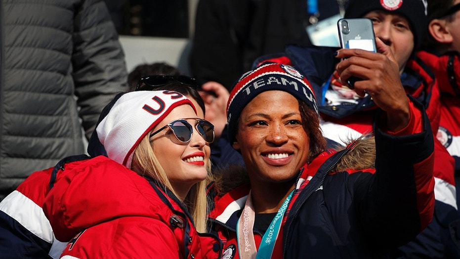 Lauren Gibbs takes a selfie with Ivanka Trump during the final day of competition at the Winter Olympics Sunday.