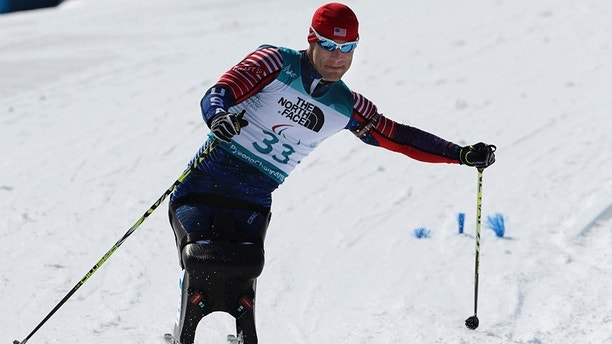 Daniel Cnossen of the United States competes in the Biathlon Sitting Men's 7.5km at the Alpensia Biathlon Centre during the 2018 Winter Paralympics in Pyeongchang, South Korea, Saturday, March 10, 2018. (AP Photo/Ng Han Guan)