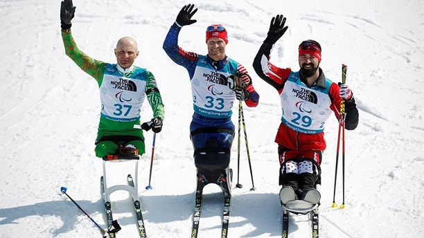 Biathlon - Pyeongchang 2018 Winter Paralympics - Men's 7.5km - Sitting - Alpensia Biathlon Centre - Pyeongchang, South Korea - March 10, 2018 - Gold medallist Daniel Cnossen (33) of the U.S., silver medallist Dzmitry Loban (37) of Belarus and bronze medallist Collin Cameron (29) of Canada. REUTERS/Carl Recine - RC1DA3C214B0