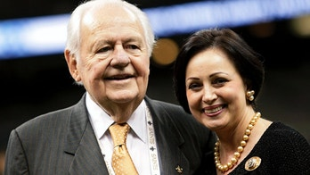 New Orleans Saints owner Tom Benson poses with his wife Gayle before his team takes on the Jacksonville Jaguars during their pre-season NFL football game at the Mercedes-Benz Superdome in New Orleans, Louisiana, August 17, 2012. REUTERS/Sean Gardner (UNITED STATES - Tags: SPORT FOOTBALL) - GM1E88I0M2U01