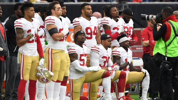 Dec 10, 2017; Houston, TX, USA; San Francisco 49ers outside linebacker Eli Harold (57), strong safety Eric Reid (35), and wide receiver Marquise Goodwin (11) kneel for the national anthem prior to the game against the Houston Texans at NRG Stadium. Mandatory Credit: Shanna Lockwood-USA TODAY Sports - 10472668