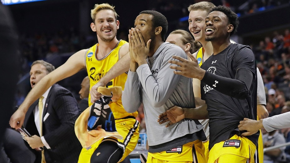 UMBC players celebrate a teammate's basket against Virginia during the second half of a first-round game in the NCAA men's college basketball tournament in Charlotte, N.C., March 16, 2018.