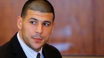 Aaron Hernandez, former player for the NFL's New England Patriots football team, attends a pre-trial hearing at the Bristol County Superior Court in Fall River, Massachusetts October 9, 2013, in connection with the death of semi-pro football player Odin Lloyd in June. Hernandez, who was a rising star in the NFL before his arrest and release by the Patriots, has pleaded not guilty.    REUTERS/Brian Snyder  (UNITED STATES - Tags: CRIME LAW SPORT FOOTBALL HEADSHOT) - GM1E9AA0A1401