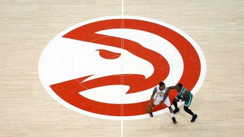 Apr 19, 2016; Atlanta, GA, USA; Atlanta Hawks guard Jeff Teague (0) is guarded against Boston Celtics guard Terry Rozier (12) near the Atlanta Hawks logo in the fourth quarter of game two of the first round of the NBA Playoffs at Philips Arena. The Hawks won 89-72. Mandatory Credit: Jason Getz-USA TODAY Sports  / Reuters 