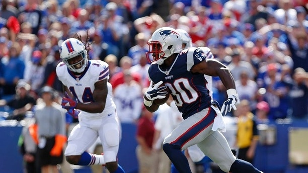 Sep 20, 2015; Orchard Park, NY, USA; New England Patriots cornerback Duron Harmon (30) runs with the ball after he intercepts a pass as Buffalo Bills wide receiver Sammy Watkins (14) pursues during the first half at Ralph Wilson Stadium. Mandatory Credit: Kevin Hoffman-USA TODAY Sports - 8814512