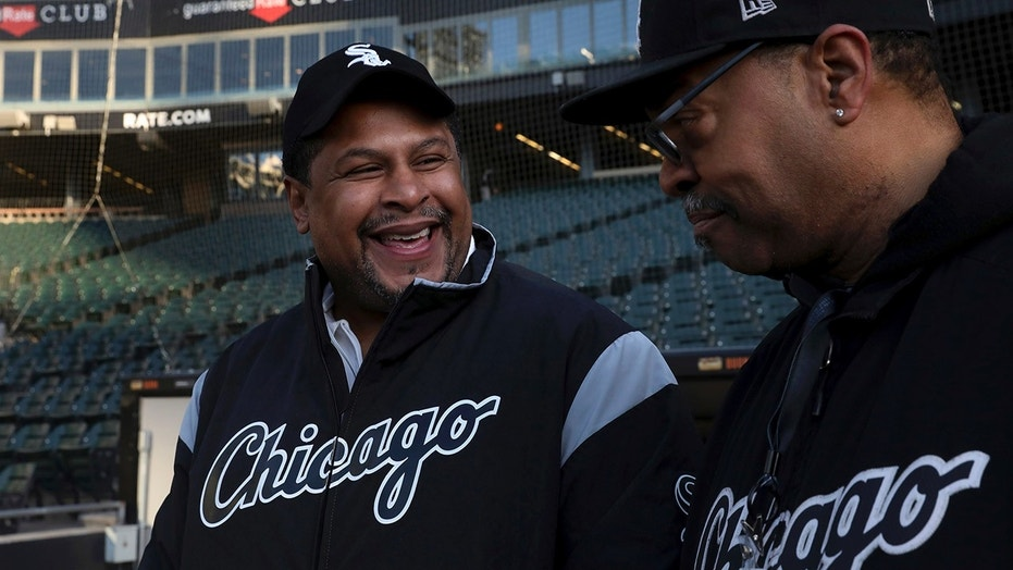 Nevest Coleman, left, smiles as fellow grounds crew and friend Harry Smith Jr. shows off some of the newer features of Guaranteed Rate Field in Chicago.