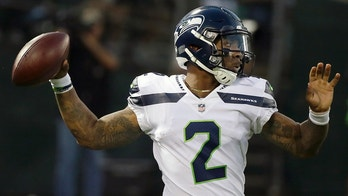 FILE - In this Aug. 31, 2017, file photo, Seattle Seahawks quarterback Trevone Boykin (2) passes against the Oakland Raiders during the first half of an NFL preseason football game in Oakland, Calif. The Seattle Seahawks released quarterback Trevone Boykin shortly after his girlfriend alleged in a television interview that he physically assaulted her in Texas. The practice squad player was released from the team Tuesday, March 27, 2018, after WFAA-TV in Dallas posted an interview with Boykin's girlfriend. She alleges he broke her jaw during an altercation last week in Mansfield, southwest of Dallas. Boykin's agent, Drew Pittman, told the station the allegations are false. Mansfield police told WFAA that Boykin is under investigation. (AP Photo/Eric Risberg, File)