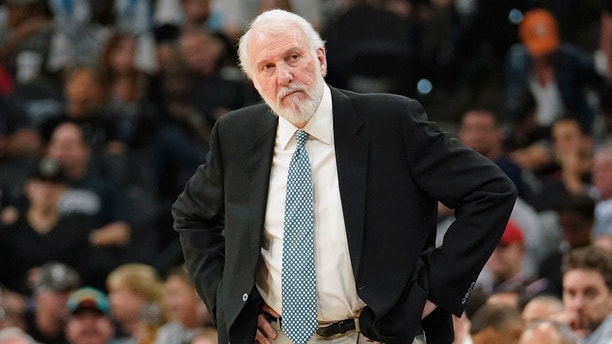 San Antonio Spurs coach Gregg Popovich reacts to a foul call during the first half of the team's NBA basketball game against the Washington Wizards, Wednesday, March 21, 2018, in San Antonio. (AP Photo/Darren Abate)