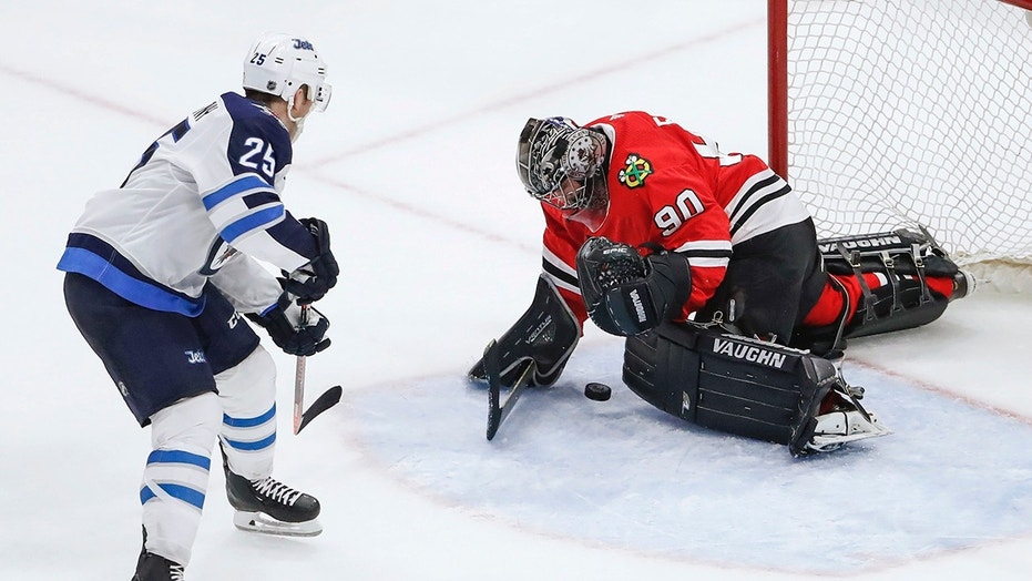 Chicago Blackhawks goalie Scott Foster defends a shot from Winnipeg Jets center Paul Stastny during the third period of a game on Thursday.