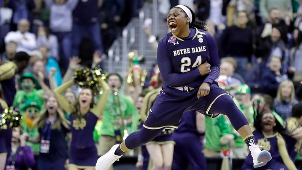 Notre Dame's Arike Ogunbowale celebrates after making the game-winning basket during overtime against Connecticut in the semifinals of the women's NCAA Final Four college basketball tournament, Friday, March 30, 2018, in Columbus, Ohio. Notre Dame won 91-89. (AP Photo/Ron Schwane)