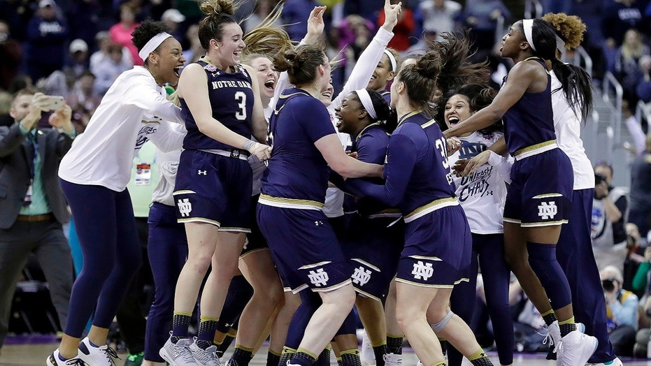 Notre Dame celebrates after defeating Connecticut in overtime in the semifinals of the women's NCAA Final Four college basketball tournament, Friday, March 30, 2018, in Columbus, Ohio. Notre Dame won 91-89.