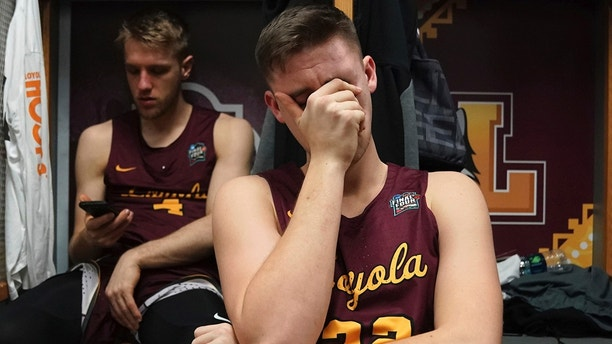 Loyola-Chicago's Carson Shanks (32) cries in the locker room after the semifinal game against Michigan in the Final Four NCAA college basketball tournament, Saturday, March 31, 2018, in San Antonio. Michigan won 69-57. (AP Photo/Eric Gay)