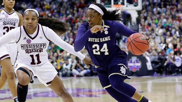 Notre Dame's Arike Ogunbowale (24) heads to the basket past Mississippi State's Roshunda Johnson (11) during the second half in the final of the women's NCAA Final Four college basketball tournament, Sunday, April 1, 2018, in Columbus, Ohio. (AP Photo/Ron Schwane)