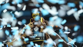 Apr 3, 2017; Phoenix, AZ, USA; North Carolina Tar Heels players hoist the national championship trophy after defeating the Gonzaga Bulldogs in the championship game of the 2017 NCAA Men's Final Four at University of Phoenix Stadium. Mandatory Credit: Bob Donnan-USA TODAY Sports - 9992205