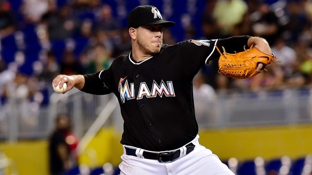 Jul 28, 2016; Miami, FL, USA; Miami Marlins starting pitcher Jose Fernandez (16) delivers a pitch during the first inning against the St. Louis Cardinals at Marlins Park. Mandatory Credit: Steve Mitchell-USA TODAY Sports - 9409053