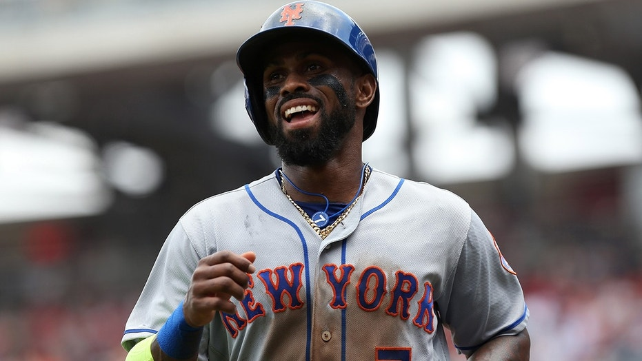 New York Mets third baseman Jose Reyes (7) smiles after scoring a run against the Washington Nationals in the first inning at Nationals Park on April 30, 2017.