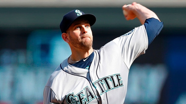 Seattle Mariners pitcher James Paxton throws against the Minnesota Twins in the first inning of a baseball game Thursday, April 5, 2018, in Minneapolis. (AP Photo/Jim Mone)