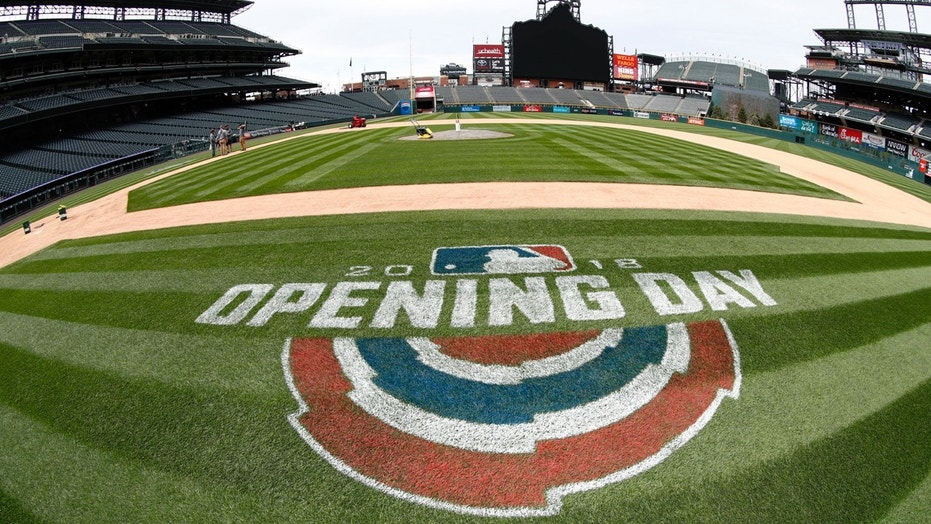 Coors Field in Denver (really) is seen as grounds crew members prepare the ballpark for the Colorado Rockies' home opener, April 5, 2018.