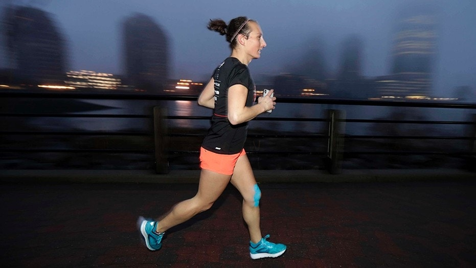 Amelia Gapin, a trangender woman, works out while preparing to run the Boston Marathon.