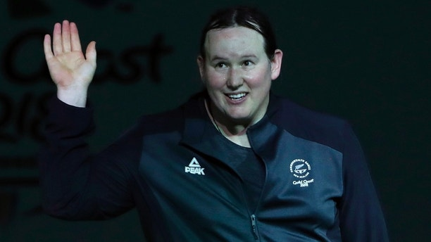 Weightlifting - Gold Coast 2018 Commonwealth Games - Women's +90kg - Final - Carrara Sports Arena 1 - Gold Coast, Australia - April 9, 2018. Laurel Hubbard of New Zealand is introduced. REUTERS/Paul Childs - UP1EE490BMG6G