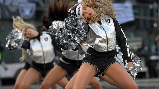 Dec 24, 2016; Oakland, CA, USA; Oakland Raiders raiderette cheerleaders pose during a NFL football game against the Indianapolis Colts at Oakland-Alameda Coliseum. Mandatory Credit: Kirby Lee-USA TODAY Sports - 9767505