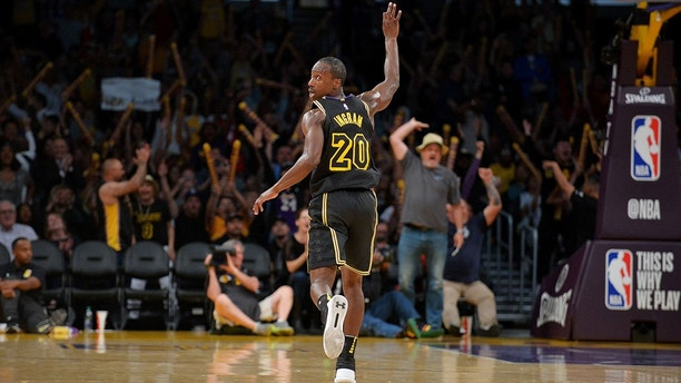 April 10, 2018; Los Angeles, CA, USA; Los Angeles Lakers guard Andre Ingram (20) reacts after he shoots a three point basket against the Houston Rockets during the second half  at Staples Center. Mandatory Credit: Gary A. Vasquez-USA TODAY Sports - 10780571