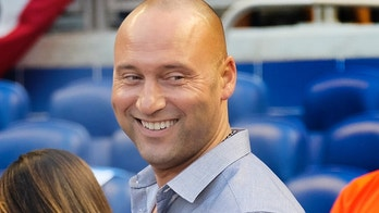 Miami Marlins CEO and part-owner Derek Jeter smiles prior to a baseball game against the Chicago Cubs in Miami, Friday, March 30, 2018. (AP Photo/Gaston De Cardenas)