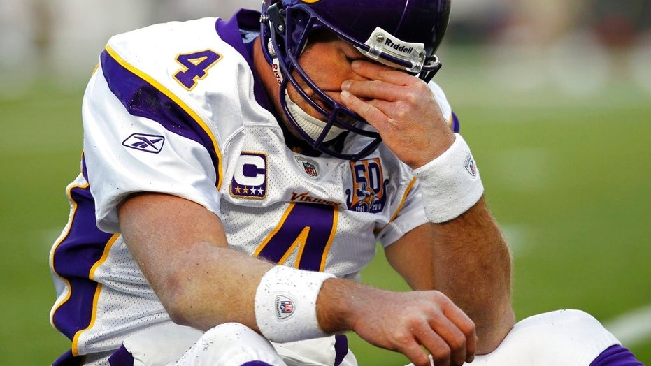 FILE 2010: Minnesota Vikings quarterback Brett Favre rubs his eyes after being hit by New England Patriots linebacker in Foxborough, Mass.