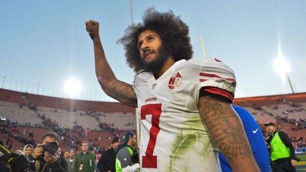 Dec 24, 2016; Los Angeles, CA, USA; San Francisco 49ers quarterback Colin Kaepernick (7) pumps his fist as he acknowledges the cheers from the 49ers' fans after leading his team to a 22-21 come-from-behind win over the Los Angeles Rams at Los Angeles Memorial Coliseum. Mandatory Credit: Robert Hanashiro-USA TODAY Sports - 9767585