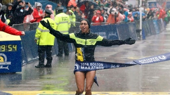 Apr 16, 2018; Boston, MA, USA; Desiree Linden of the USA hits the tape to win the Women's Division of the 2018 Boston Marathon. Mandatory Credit: Winslow Townson-USA TODAY Sports - 10788846