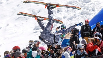 A participant of the Red Bull Slopesoakers Pond Skimming competition, Hayden Wright, 26, flies crowd from the jump during the event Saturday, April 14, 2018 at Copper Mountain, Colo. The crash resulted a broken collarbone of a women spectator and several other injuries. (Hugh Carey/Summit Daily News via AP)
