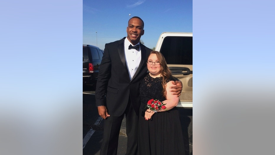 Don Jones and Lindsey Preston pose for a prom photo on April 13.
