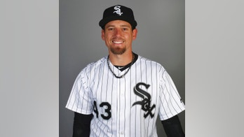 This is a 2018 photo of Danny Farquhar of the Chicago White Sox baseball team. White Sox reliever Farquhar suffered a brain hemorrhage during a game and is in stable but critical condition. Farquhar passed out in the dugout in the sixth inning Friday, April 20, 2018, and was helped by team medical personnel and on-site EMTs. He regained consciousness before he was taken to a hospital by ambulance. (AP Photo/Ben Margot)