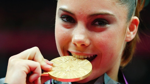 McKayla Maroneys of the U.S. poses with her gold medal during a ceremony after the women's gymnastics team final in the North Greenwich Arena at the London 2012 Olympic Games July 31, 2012.         REUTERS/Brian Snyder (BRITAIN  - Tags: SPORT GYMNASTICS HEADSHOT OLYMPICS)   - LM2E87V1F3F7X
