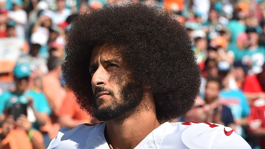 Nov. 27, 2016: Colin Kaepernick looks on before a game against the Miami Dolphins at Hard Rock Stadium.