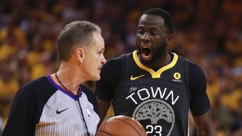 Golden State Warriors' Draymond Green, right, discusses a call with Mike Callahan during the second half in Game 2 of the team's second-round NBA basketball playoff series against the New Orleans Pelicans on Tuesday, May 1, 2018, in Oakland, Calif. (AP Photo/Ben Margot)