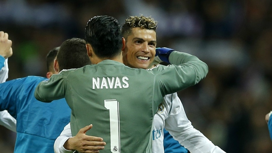 Real Madrid goalkeeper Keylor Navas, left, hugs teammate Cristiano Ronaldo after Real defeated Bayern Munich on Tuesday, to advance to the UEFA Champions League final on May 26 in Kiev, Ukraine.