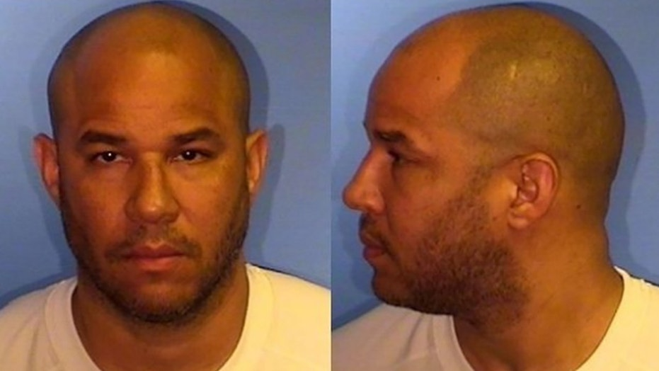 Picture shows Rick Brunson in 2014 when he was arrested in Illinois on aggravated battery and attempted sexual assault charges.