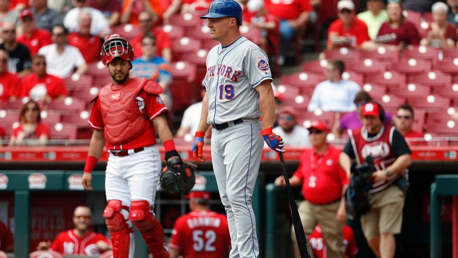 New York Mets outfielder Jay Bruce stands at home plate after umpire Game Morales called an out on the Mets for batting out of order Wednesday afternoon against the Cincinnati Reds