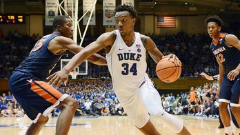 Jan 27, 2018; Durham, NC, USA; Duke Blue Devils forward Wendell Carter Jr. (34) drives to the basket as Virginia Cavaliers forward Mamadi Diakite (25) defends during the second half at Cameron Indoor Stadium. Virginia won 65-63. Mandatory Credit: Rob Kinnan-USA TODAY Sports - 10569650