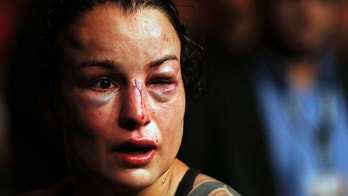 Raquel Pennington, from the United States, leaves the octagon after losing the UFC women's bantamweight mixed martial arts bout against Amanda Nunes, from Brazil, in Rio de Janeiro, Brazil, early Sunday, May 13, 2018. (AP Photo/Leo Correa)