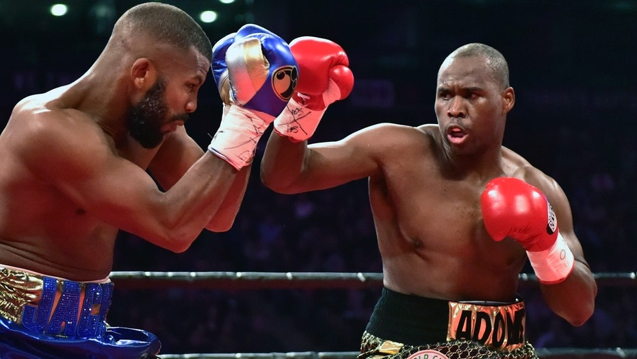 Adonis Stevenson, right, and Badou Jack exchange blows during the first round of the WBC light heavyweight championship boxing match in Toronto on Saturday