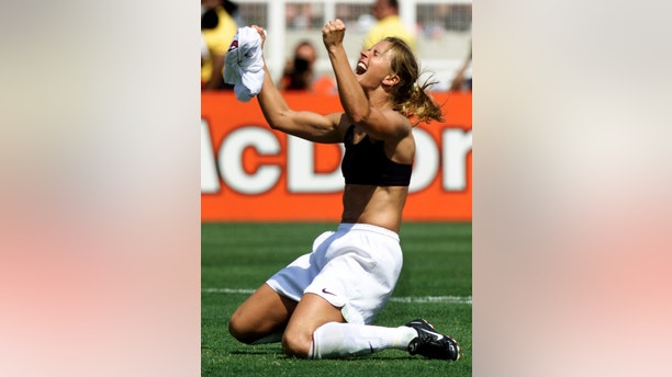 United States midfielder Brandi Chastain celebrates her winning penalty kick to defeat China 5-4 at the Women's World Cup soccer final between the two countries July 10 at the Rose Bowl. The United States women's national soccer team were named Sportswomen of the Year (1999) by Sports Illustrated magazine.