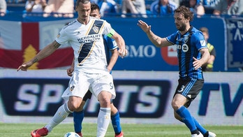 Montreal Impact's Marco Donadel moves in on Los Angeles Galaxy's Zlatan Ibrahimovic, left, during the first half an MLS soccer match in Montreal, Monday, May 21, 2018. (Graham Hughes/The Canadian Press via AP)