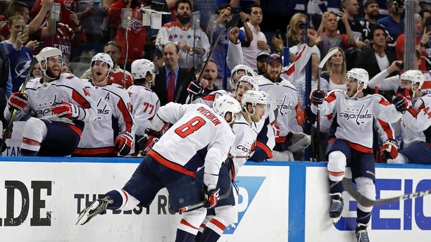 Washington Capitals, including left wing Alex Ovechkin (8). celebrate after defeating the Tampa Bay Lightning in Game 7 of the NHL Eastern Conference finals hockey playoff series Wednesday, May 23, 2018, in Tampa, Fla. (AP Photo/Chris O'Meara)