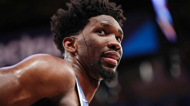 FILE - In this March 15, 2018, file photo, Philadelphia 76ers' Joel Embiid (21) talks to spectators during the second half of the team's NBA basketball game against the New York Knicks in New York. 76ers general manager Bryan Colangelo is denying a report connecting the executive to Twitter accounts that criticized Sixers players Embiid and Markelle Fultz, among other NBA figures. The accounts also took aim at former Sixers GM Sam Hinkie, Toronto Raptors executive Masai Ujiri and former Sixers players Jahlil Okafor and Nerlens Noel, according to a report by The Ringer (AP Photo/Frank Franklin II, File)