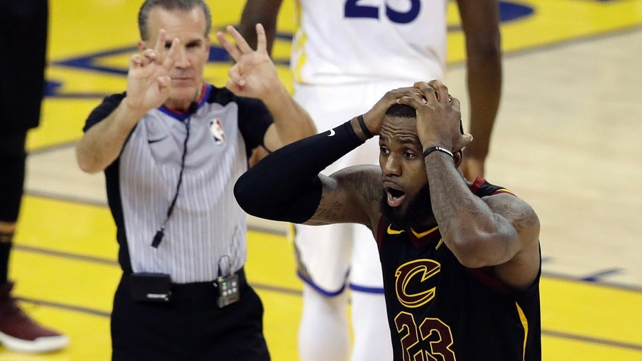 Cleveland Cavaliers forward LeBron James (23) reacts to a call during the second half of Game 1 of basketball's NBA Finals between the Golden State Warriors and the Cavaliers in Oakland, Calif.