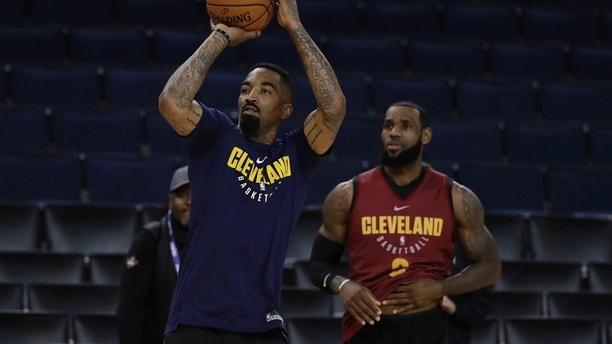 Cleveland Cavaliers' J.R. Smith, left, shoots as his teammate LeBron James watches during an NBA basketball practice, Wednesday, May 30, 2018, in Oakland, Calif. The Cavaliers face the Golden State Warriors in Game 1 of the NBA Finals on Thursday in Oakland. (AP Photo/Marcio Jose Sanchez)