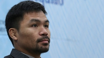 Philippine Senator and boxing hero Manny Pacquiao listens to a reporter's question after the Seoul Global Ambassador appointment ceremony at the Seoul City Hall in Seoul, South Korea, Tuesday, Dec. 26, 2017.  Pacquiao arrived in South Korea last week with his family and also visited the National Assembly. (AP Photo/Lee Jin-man)